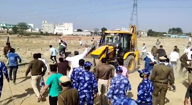 stone pelting on administration team two injured including jcb driver