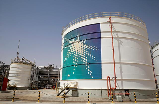 saudi aramco profit slumps after covid battered year