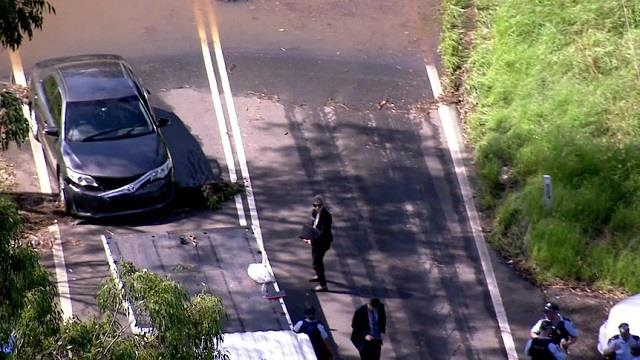 man dead after becoming trapped in a car in floodwater in sydney
