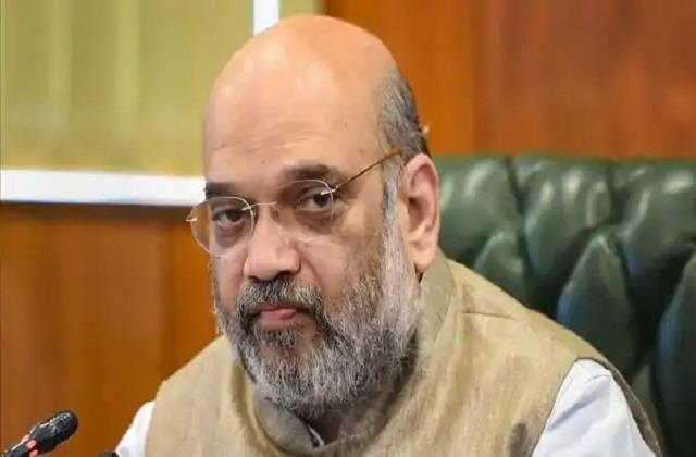 amit shah took the first dose of corona after pm modi