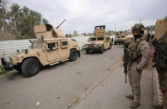 rocket attack on iraqi air base two security personnel injured