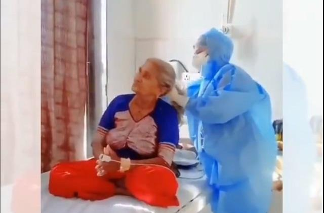 heart touching video doctor made ponytail of corona patient