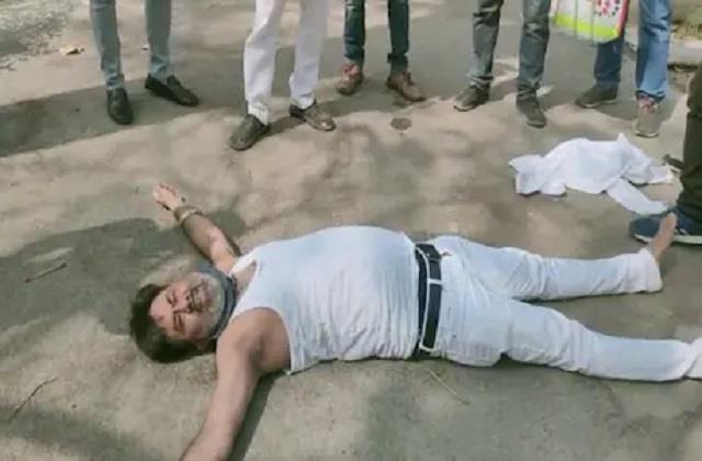 bjp mla at dm residence lying on the ground tore clothes