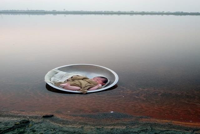 unknown woman s black handiwork throws newborn in yamuna river