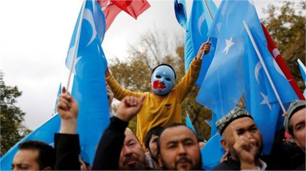 china carrying out slow genocide of uyghurs in xinjiang report