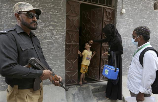 two pakistani police officers protecting polio jab team shot dead