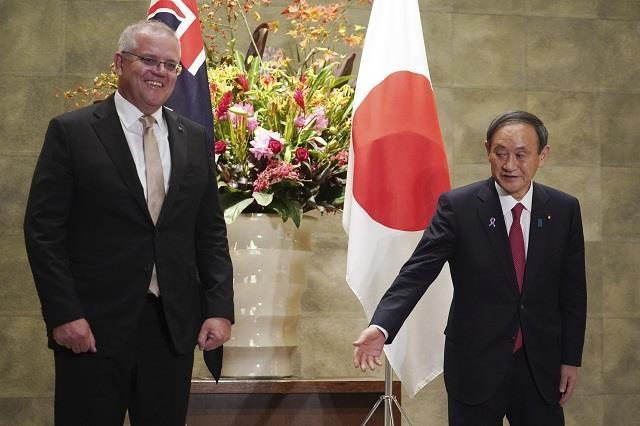 japan australia share china concerns raise defence ties