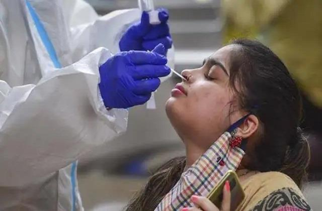 covid 19 22 056 new cases 131 deaths in kerala
