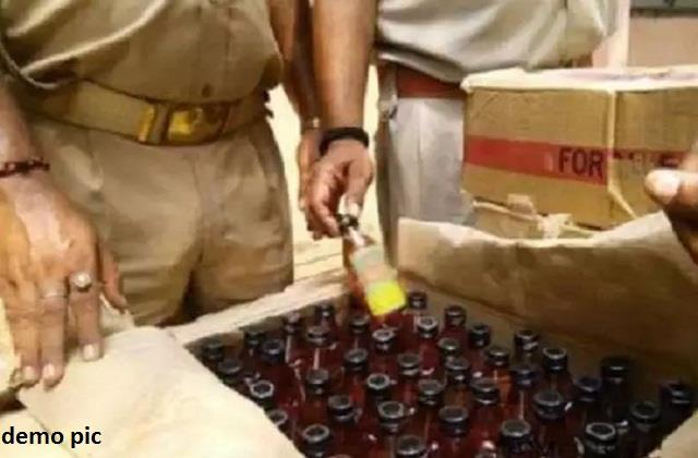 two guns and liquor recovered from the house of a liquor trader