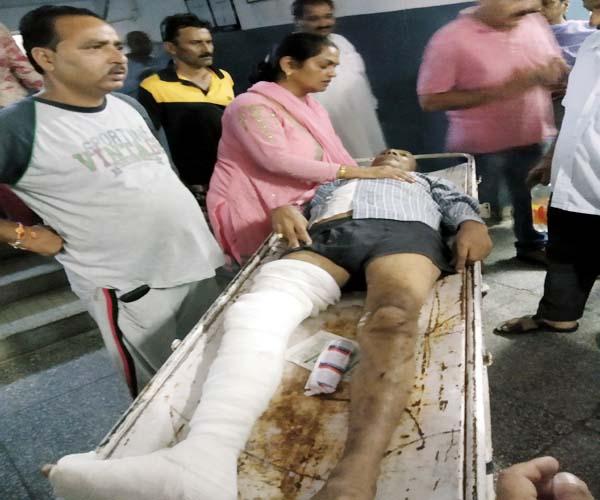 PunjabKesari, Injured Man Image