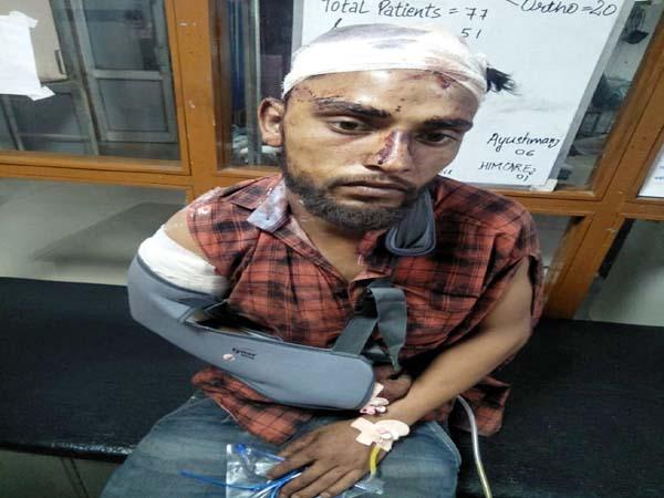 PunjabKesari, Injured Bike Rider Image